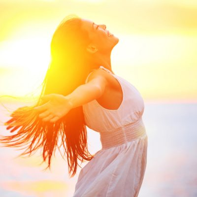 Enjoyment – free happy woman enjoying sunset